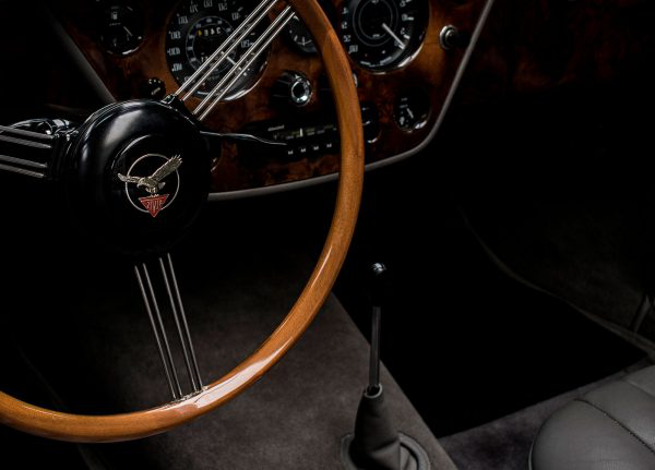 Chloe Wilson - Image of the interior of a sports car featuring the steering wheel