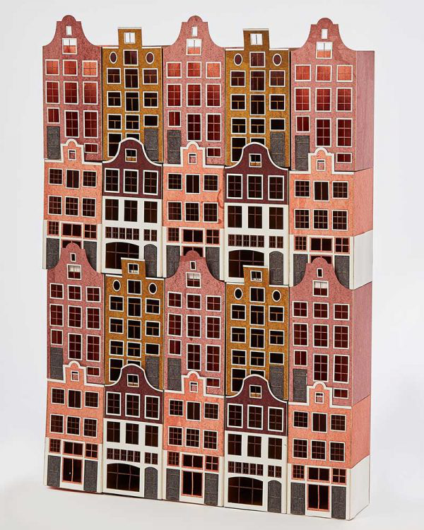 Danielle Taylor - Image of a 3d sculpture of small houses stacked and lined in a row