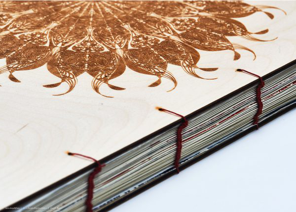 Emily Beavis - Image of bound publication with a wooden cover