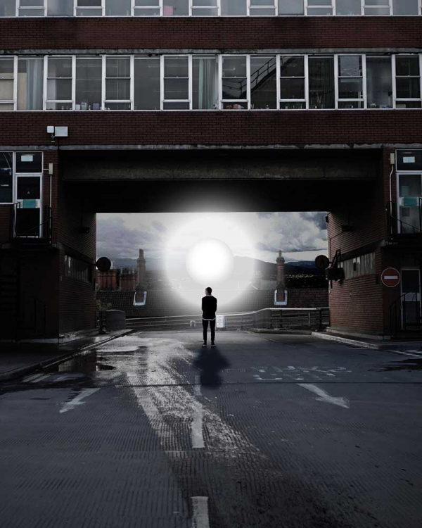 Fahim Fadzlishah - Image of a person standing below a bridge with a light orb standing