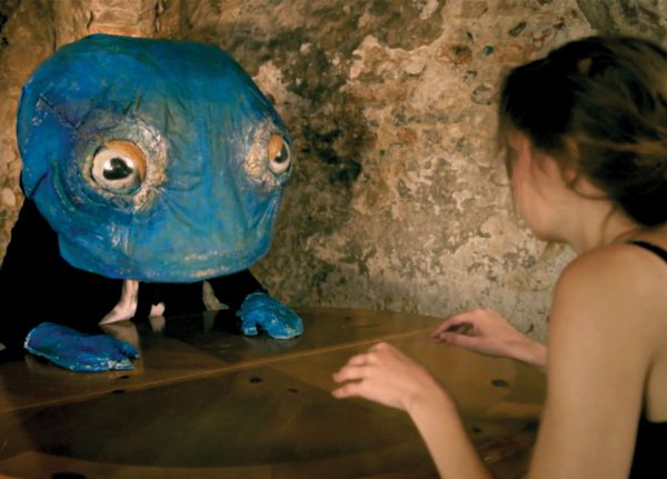 Lila Babington - Image of a girl talking to a blue stop motion puppet