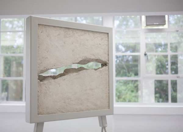 Chrissy Leech - Image of a concret square with a carved line through the middle of it