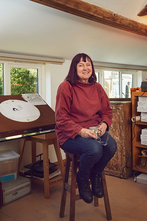 Professor of 动画 Suzie Hanna sits in her home-made studio in Norwich