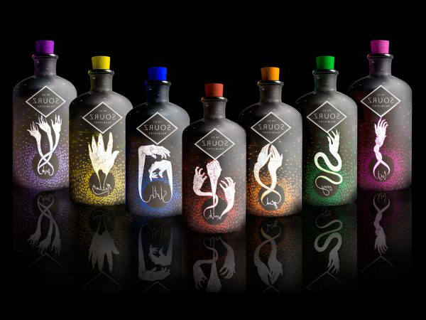 Laura Edwards - Image of designed sour shots bottles featuring illustrations of snakes and bright colours