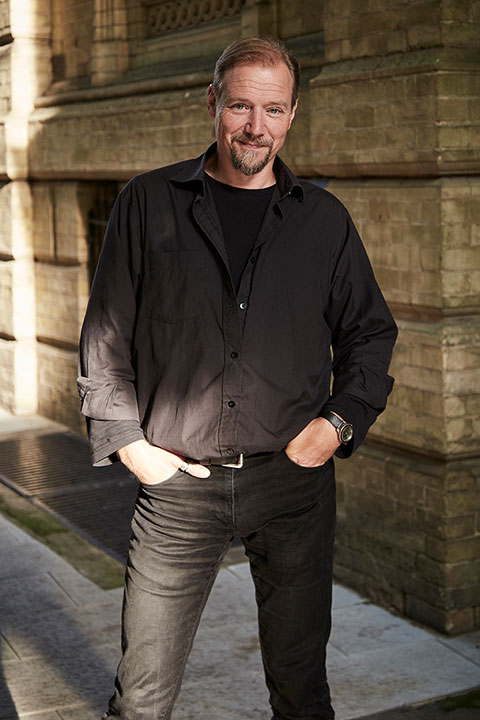 Nigel Potter, Lecturer in Games Art and Design standing outside of Boardman House at Norwich University of the Arts