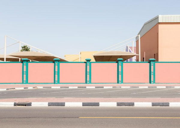 Lara Chandler - Photo of a wall by BA Photography student Lara Chandler. The wall is pink with green stripes and located next to a road in Dubai.