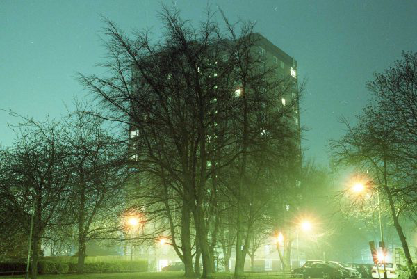 Elliot Knott - Building behind some trees with bright lights by MA Photography student Elliot Knott