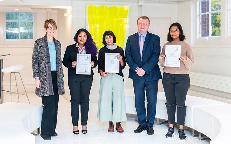 Some of the 2019-20 international scholarship award winners with their award certificates alongside Neil Powell and Hilary Carlisle