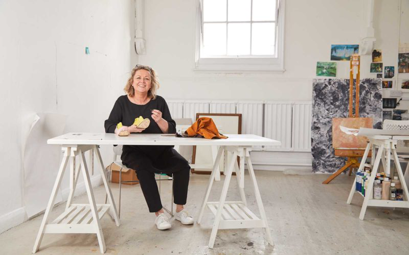 Marie Brennan, Head of postgraduate study at Norwich University of the Arts sits in the MA Fine Art studio with her own work